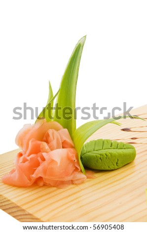 Decoration And Flavouring For Sushi On Wooden Plate