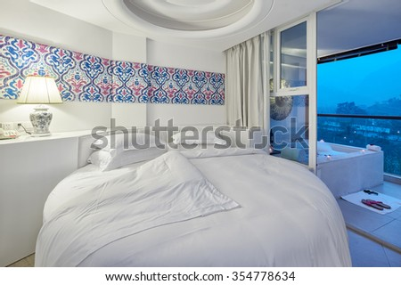 decoration and furniture of modern bedroom with comfortable bed - stock photo
