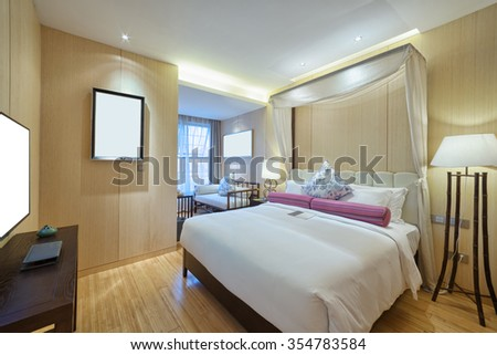 decoration and furniture of modern bedroom with comfortable bed
