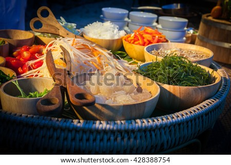 Decoration and raw foods prepared for the wedding dinner party.