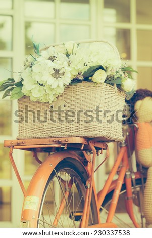 Decoration artificial flower in basket on bicycle - stock photo