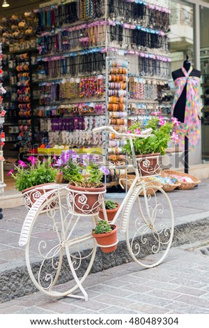 Decoration bicycle with flower pot in market background in summer