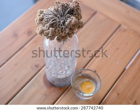 Decoration dried flower on the wooden table - stock photo
