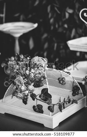 Decoration for parties with colorful flowers, shallow focus, abstract present gift decor vertical black and white
