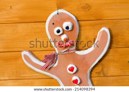 Decoration in the form of the fake  toy man  on the home wooden wall  - stock photo