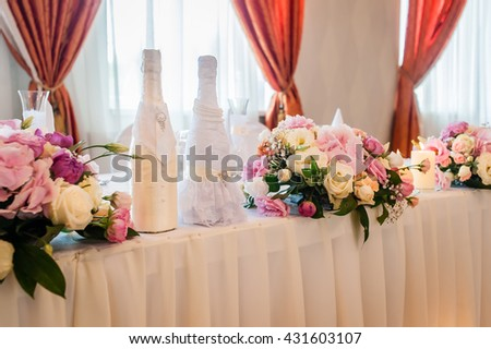 Decoration of a wedding table champagne and fresh flowers