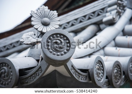 Decoration of ancient temple roof in Kyoto, Japan