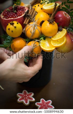 decoration of Christmas gifts, making bouquets of fruits