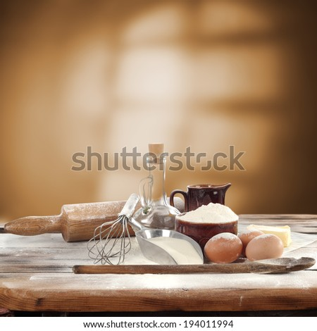 decoration of flour oil eggs milk spoon and window shadow  - stock photo