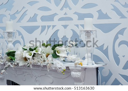 decoration of flowers and candles at the wedding table in a restaurant