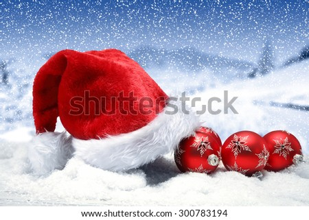 decoration of red hat few red balls and snow top  - stock photo