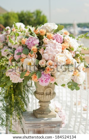 Decoration of weddingceremony. Flowers in vase. - stock photo