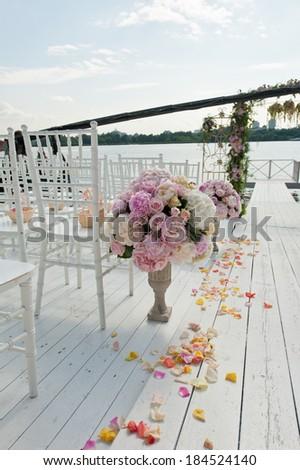 Decoration of weddingceremony. Flowers in vase. - stock photo