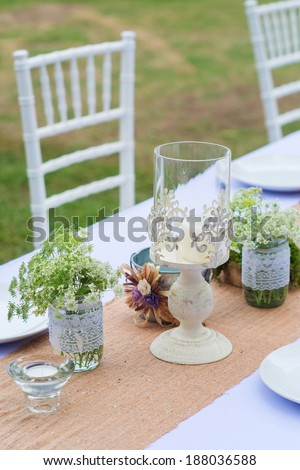 decoration on the table at outdoor wedding party - stock photo