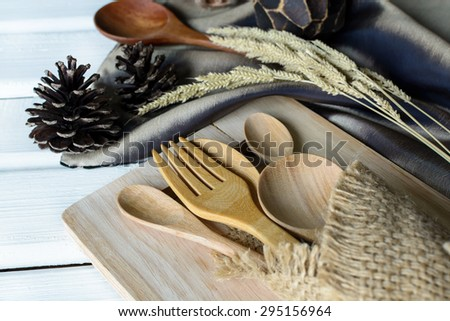 Decoration Seasonal table setting with wooden spoon and fork on white wooden table