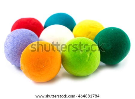 Decoration toys isolated on white background. Christmas tree ornament in shape of sphere. Happy New Year. Pile of colorful balls without holders. Lot of toys lying with shadow. Made of soft material.