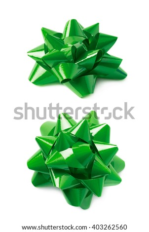 Decorational green ribbon gift bow isolated over the white background, set collection of two diffirent foreshortenings - stock photo