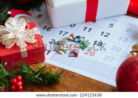 Decorations and calendar with Christmas Day marked out - stock photo