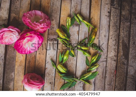 decorations for March 8 Women's Day celebration , flowers buds eustomy number 8 written on wooden brown rustic Josquin in stie
