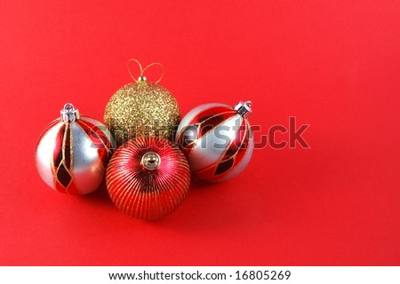 Decorations for the Christmas tree brightly lit on red background