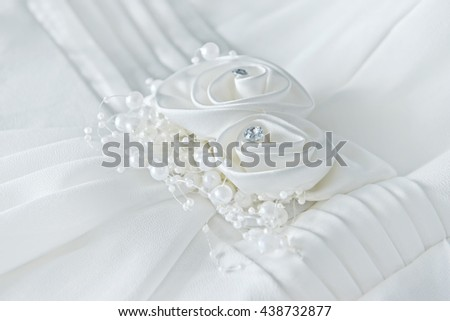 Decorations of white wedding dress closeup