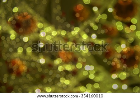 Decorations on the Christmas lights and the general pattern in sparkling blurred background - stock photo