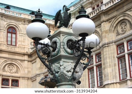 decorations on the street lamp in front of the Vienna Opera, Austria. - stock photo