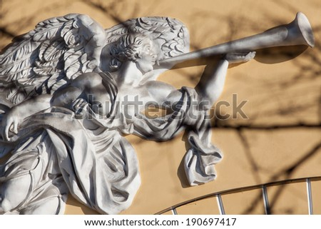 Decorative angel with trumpet at the wall of the Admiralty in St. Petersburg, Russia