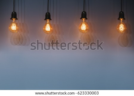 Decorative antique edison style light bulbs against wall background. Selective focus.