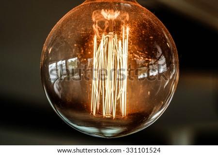 Decorative antique light bulb - stock photo