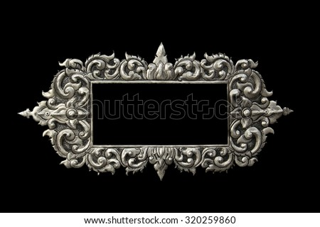 Decorative Art of Lanna Thai. silver carving art on temple wall. Wat Srisuphan, Chiang mai, Thailand - stock photo