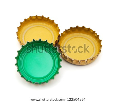 Decorative beer caps on white background