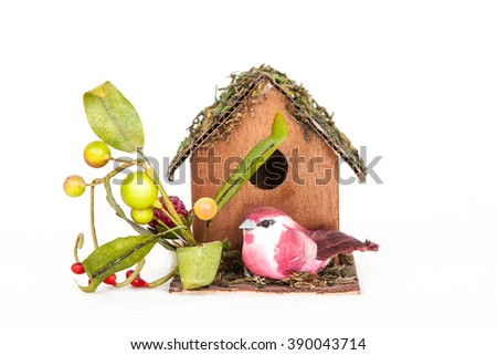 decorative birdhouse with bird isolated on a white background.