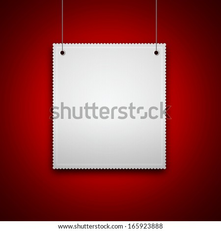 decorative blank hanging on red wall with place for text - stock photo