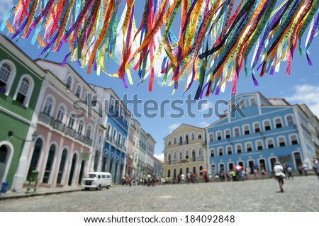 Decorative Brazilian wish ribbons waving in the sky above colonial architecture of Pelourinho Salvador Bahia Brazil - stock photo