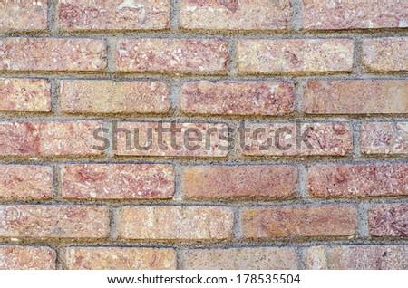 Decorative brick tiles on a wall texture. - stock photo