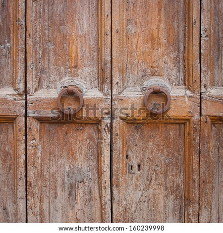 Decorative bronze door knob handle on wooden door - stock photo
