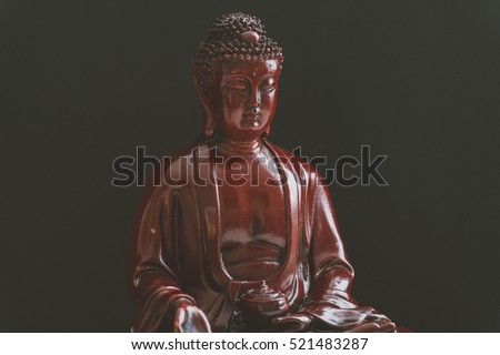 Decorative Buddha statue, Buddha in the background of incense, Shakyamuni attained enlightenment. The symbol of Buddhism. Film texture and shallow focus