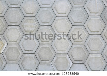 decorative cell-shaped concrete wall - stock photo