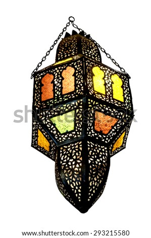 Decorative chandelier made of black metal inlaid with colored glasses inserted in small windows - stock photo