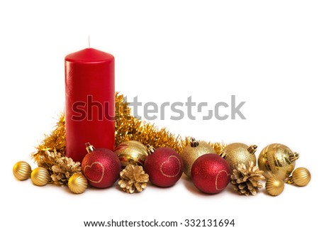 Decorative christmas composition from red candle, with red and gold balls and pine cones - stock photo