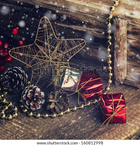 Decorative christmas composition on old wooden background. Christmas postcard. Vintage style. - stock photo