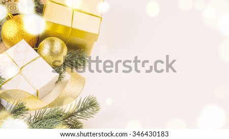 decorative christmas gift boxes and balls on white surface, view from above