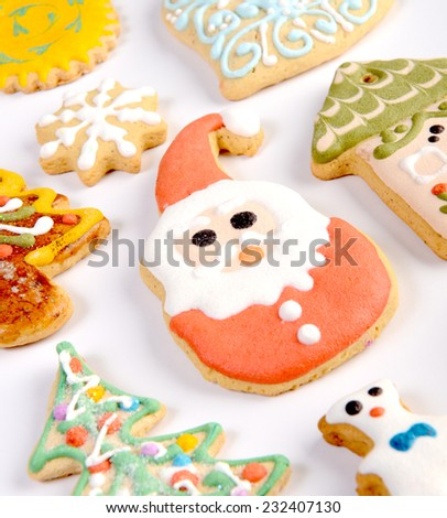 Decorative christmas gingerbread cookies with icing on white backround