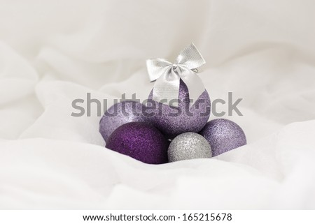 Decorative Christmas ornaments with pretty purple baubles - stock photo