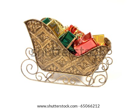 Decorative Christmas sleigh filled with colorfully wrapped gifts - stock photo