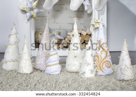 Decorative Christmas tree made of cloth and fireplace. Photographed in the studio interior