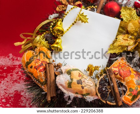Decorative Christmas wreath on a red background with place for your text. - stock photo