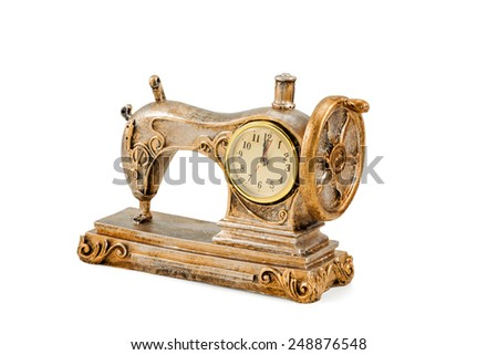 Decorative clock in the form of an old sewing machine isolated on a white background - stock photo