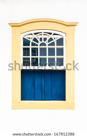 Decorative, colonial, beige, vintage, window on a white wall in Paraty (or Parati), Brazil. - stock photo